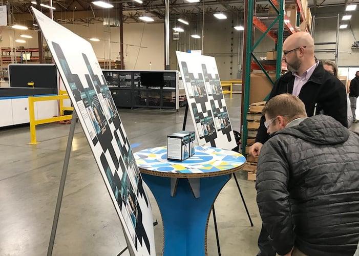 Sales Reps looking at digital print